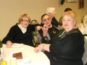Images of people at B'nai B'rith's Covenant House Communities 2012 Holiday party.