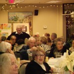 Image of people celebrating at B'nai B'rith's Covenant House Communities' 2012 Holiday party.