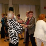 Image of Holiday dancing and celebrations at B'nai B'rith's Covenant House' 2012 party.