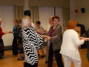Image of Holiday dancing and celebrations at B'nai B'rith's Covenant House' 2012 party.