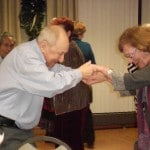 Image of Senior Dance Party Holiday smiles at B'nai B'rith's Covenant House Communities in 2012.