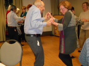 Image of people dancing at B'nai B'rith's Covenant House Communities 2012 Holiday party.