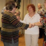 Image of Group holiday party dancing at B'nai B'rith's Covenant House Communities in 2012.