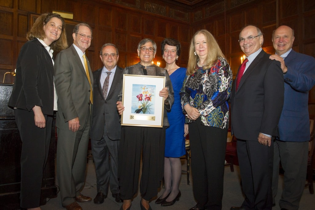 Image of Pam Goodman receiving 2014 Distinguished Achievement Award, was celebrating Pam's contributions to affordable housing as well as her commitment to our organization.