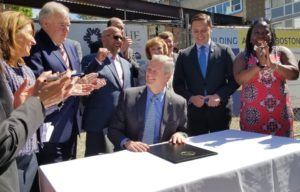 Massachusetts Gov. Charlie Baker signs $1.8 billion bill authorizing spending on housing modernization and redevelopment